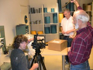 Leigh Mierke and John Zainer film Ed Carter opening KUKAN shipping box.