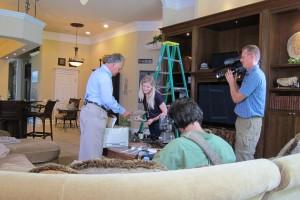 Mark Scott and Michelle Scott examine Rey Scott's cameras