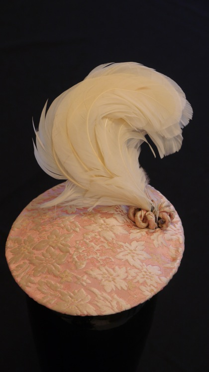 Photo of Nick Savage pink brocade plumed hat owned by Li Ling-Ai