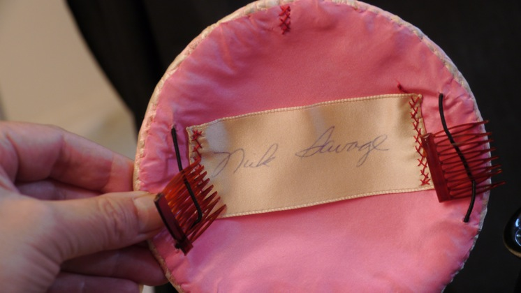 Photo of inside of pink brocade hat