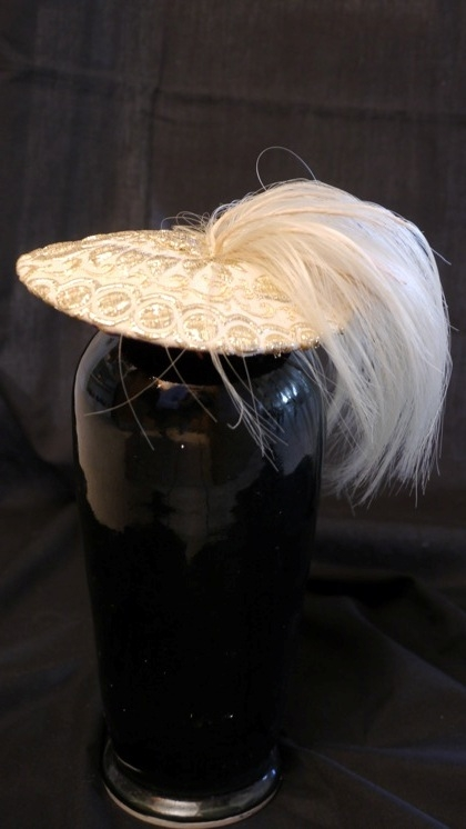 Photo of gold ponytail hat by Nick Savage.
