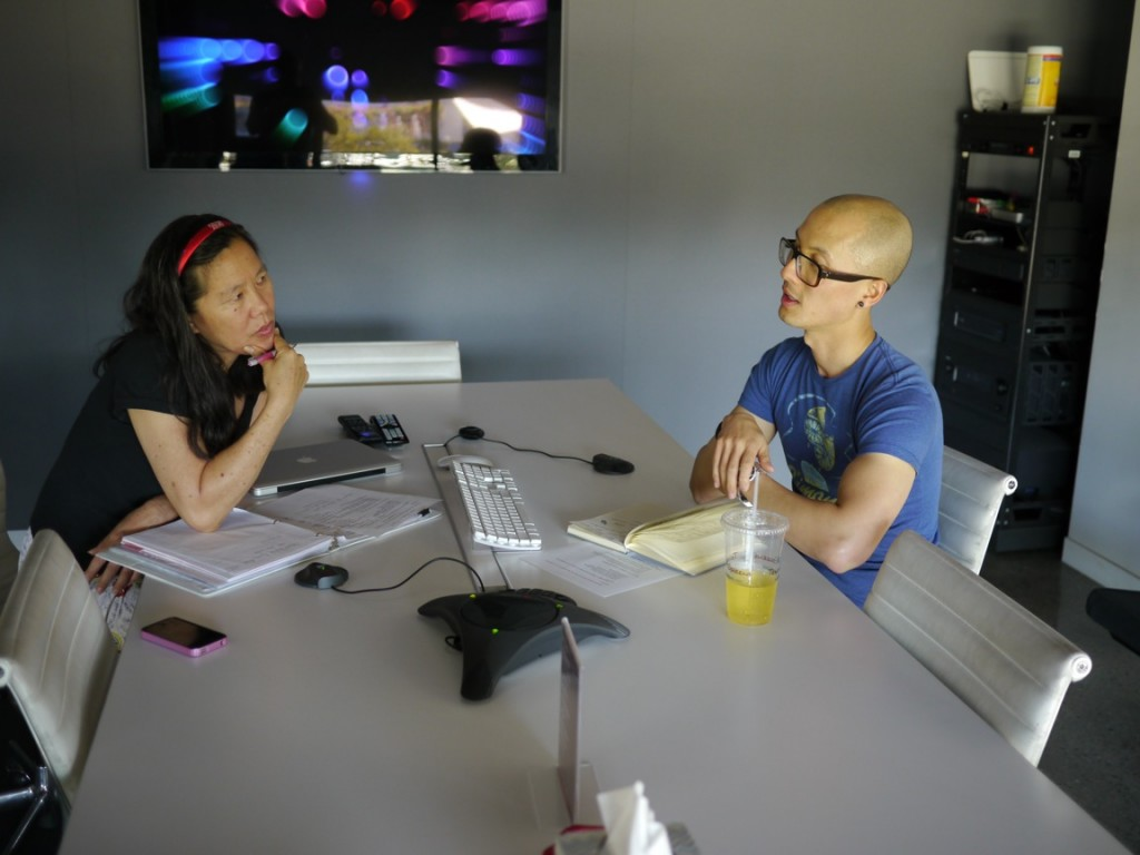 Chris Do helps Robin Lung lay out a plan of action for creating FINDING KUKAN's shadow scenes.