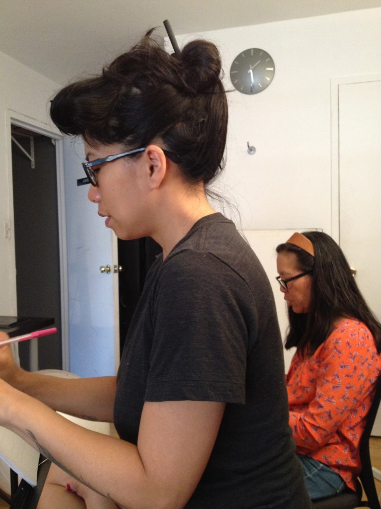 Going over scripts with Calamity Chang.