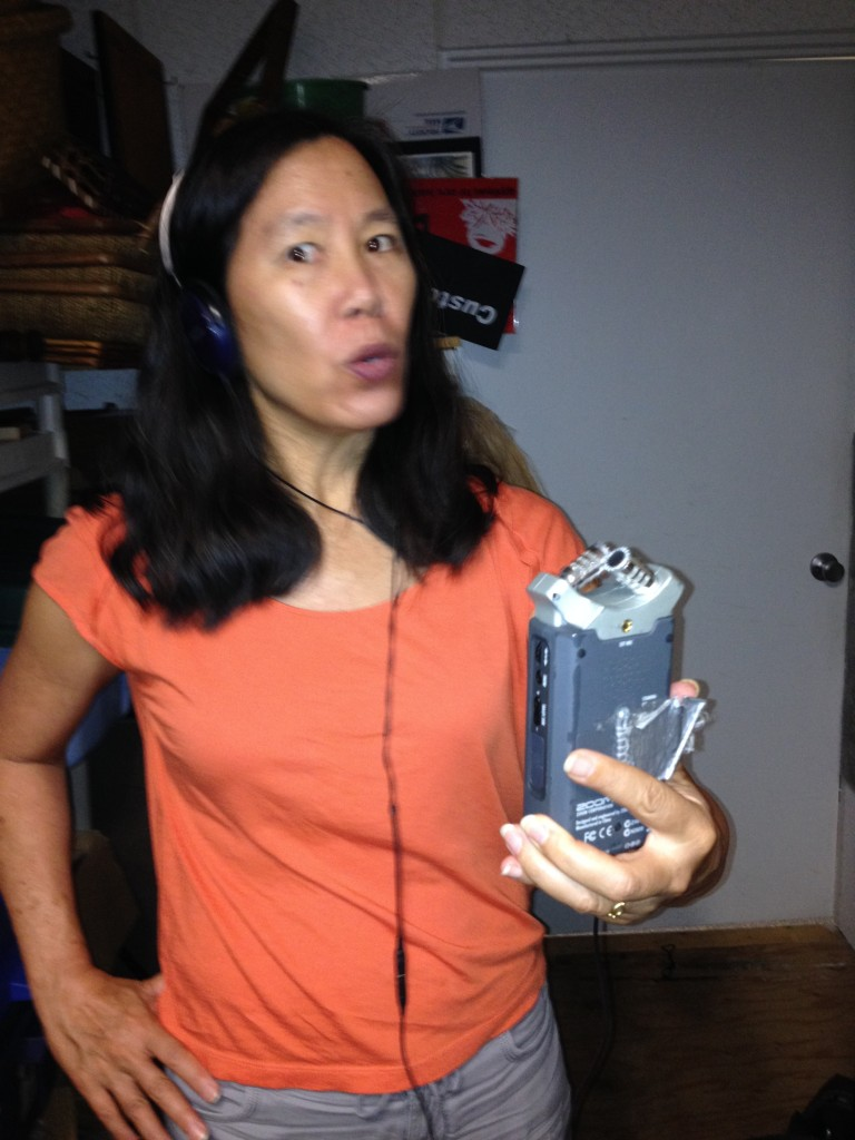 Robin records temporary narration in the sound-proof storage closet at Rubber Stamp Plantation in Honolulu