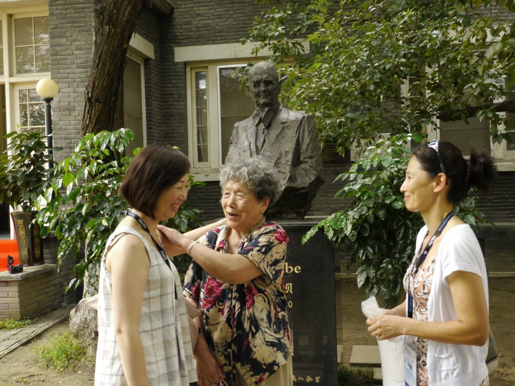 At the John Rabe House study tour leader FLora Chong and Judy Cho greet Nanjing Massacre survivor Ding Zheng Lan who was sheltered in the Safety Zone created by Rabe and several other westerners who remained in Nanjing during the massacre in 1937.