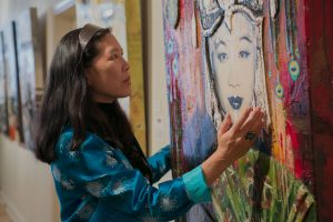 Director Robin Lung with portrait of Li Ling-Ai (photo credit: Michelle Scott)